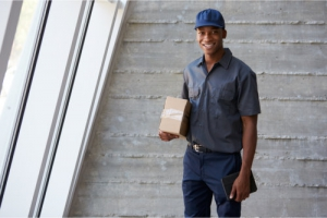 Portrait of courier collecting package from office